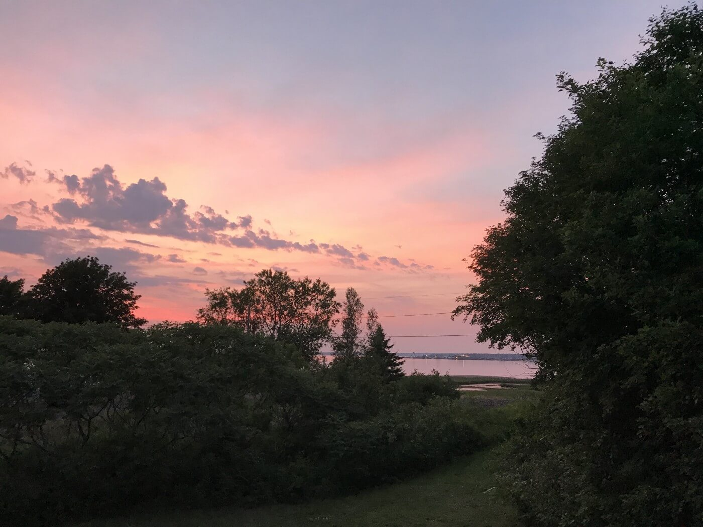 View of the Northumberland Strait at summer sunset from my deck in Point du Chene, New Brunswick, Canada