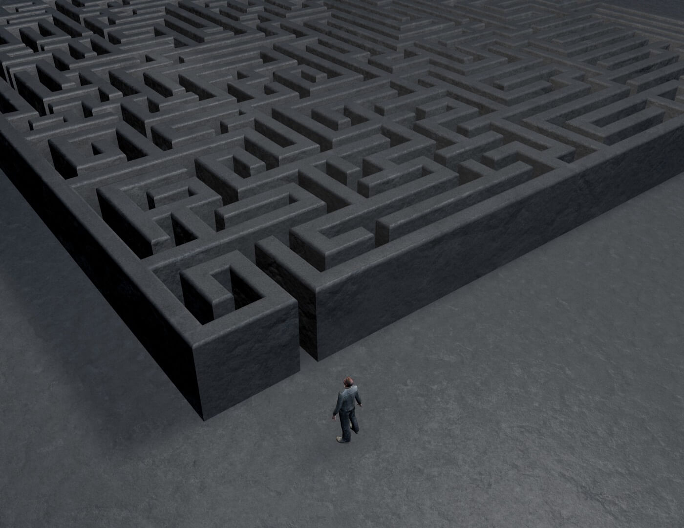 Dark convoluted maze with cartoon person standing outside of the entrance