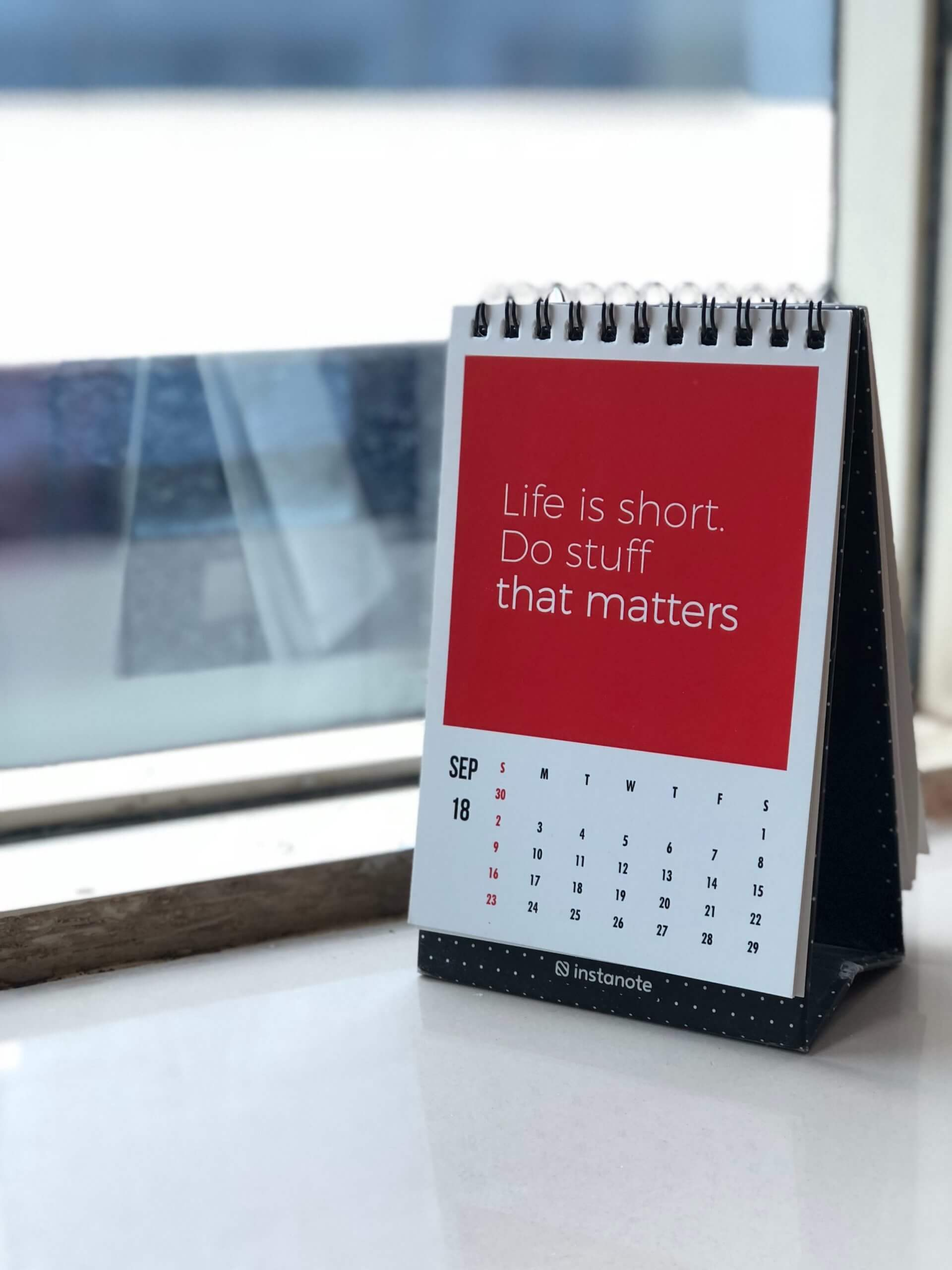 "Red desk calendar that says ""Life is short. Do stuff that matters"""
