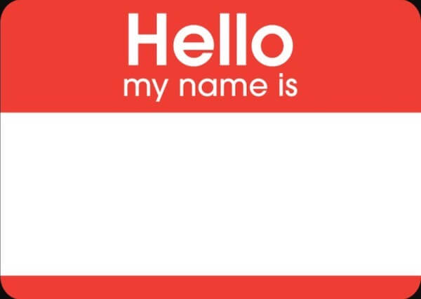 "Red ""hello my name is"" sticker with a blank space for the name"