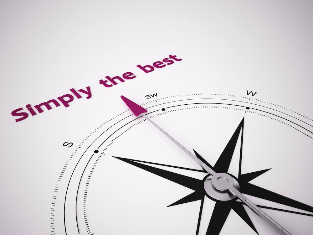 "Compass pointing to the words ""Simply the best"""